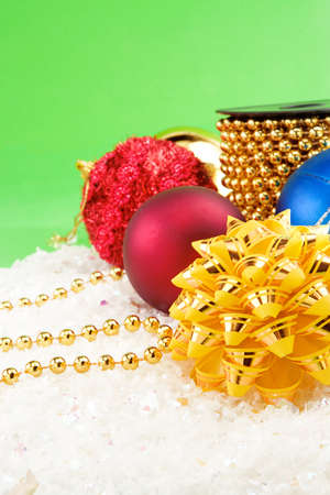 christmas decoration with snow on green background Stock Photo - 13793994