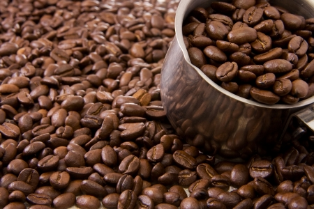 pot full of coffee beans photo