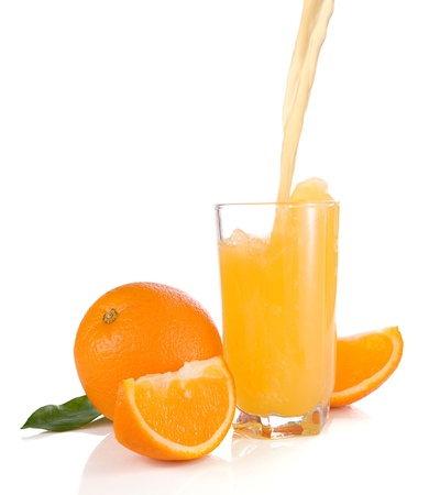 flowing juice and orange isolated on white background photo