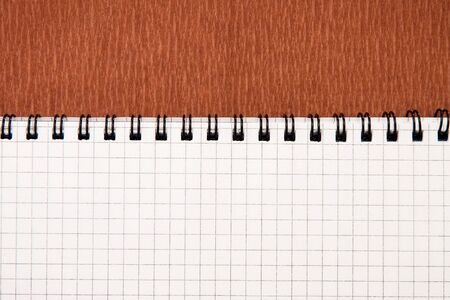crosshatching: red background texture and checked notebook
