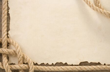 ship ropes on old vintage ancient paper parchment background texture photo