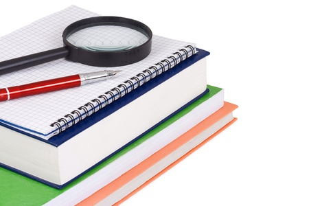 magnifying glass and pen on books photo