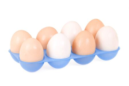 blue plastic container and eggs photo