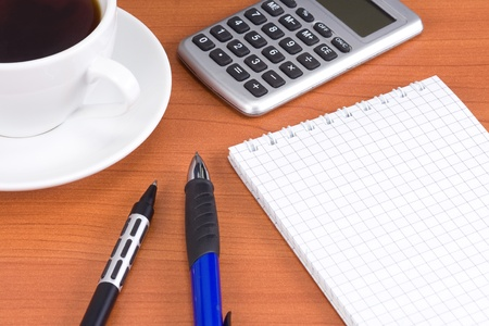 cup of coffee and office accessories photo