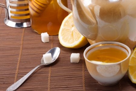 tea, pot and honey on table  photo