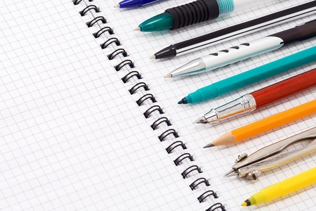 vertical dividers: pens and pencils on pad