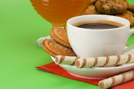 coffee, honey and cookies on table photo
