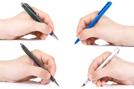 horizontal image of hand holding plastic pen  photo