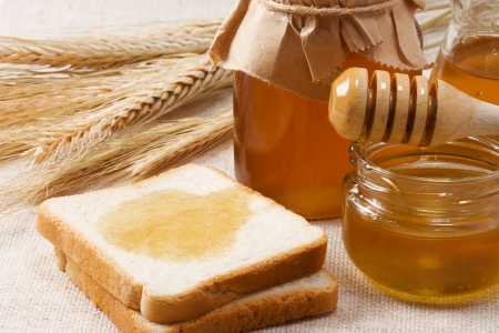 bread and honey on sacking photo