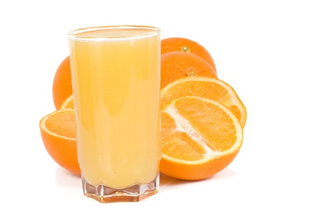 standing glass with juice and oranges photo