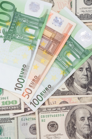 vertical image of dollars and euros background photo