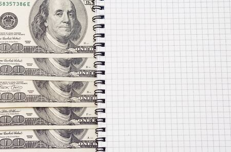 dollars and binder checked pad Stock Photo - 14021694