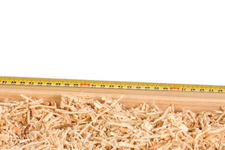 tape measure and wood sawdust products photo
