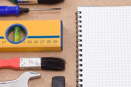 horizontal image of tools and pad Stock Photo - 14021654