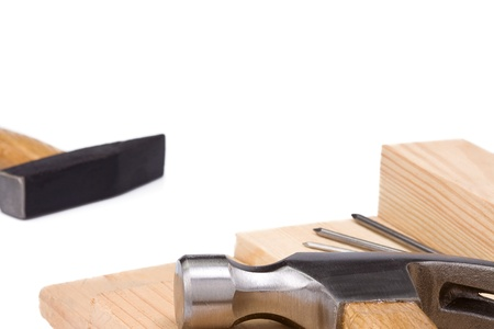 isolated hammers and nail on wood brick Stock Photo - 14021485