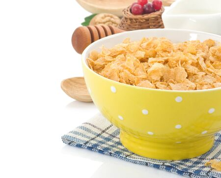 Bowl of corn flakes and milk isolated on white background photo