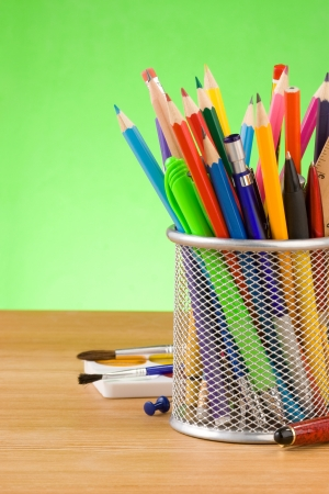 back to school concept and office supplies on green background photo