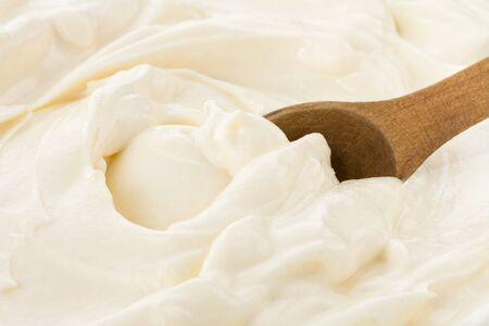 ifestyle: wood spoon in sour cream