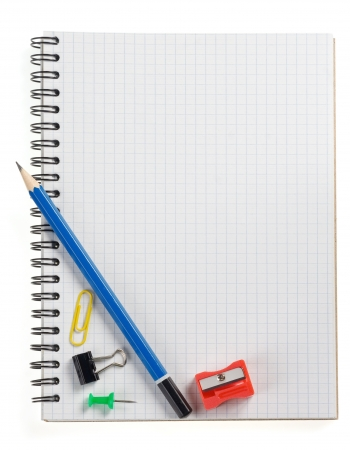 pencil on checked notebook isolated on white background photo