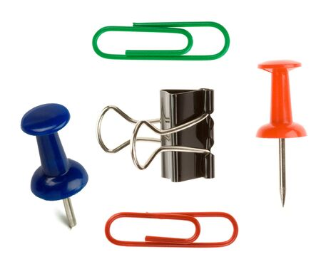 close up pushpin and paper clip on white background photo