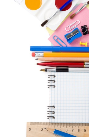 school supplies and checked isolated on white background photo