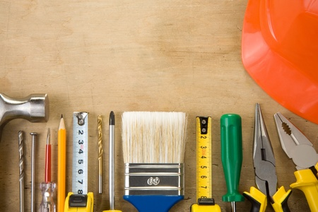 set of construction tools on wood texture background photo