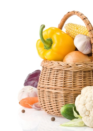 healthy vegetable food and basket isolated on white background photo