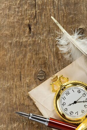 ink pen and watch on wooden background Stock Photo - 14383940