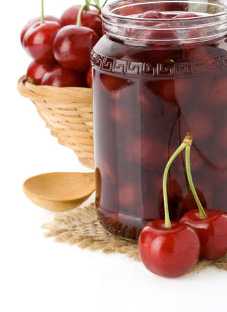 cherry jam isolated on white background photo