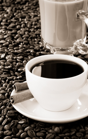 cup of coffee and roasted beans as background photo