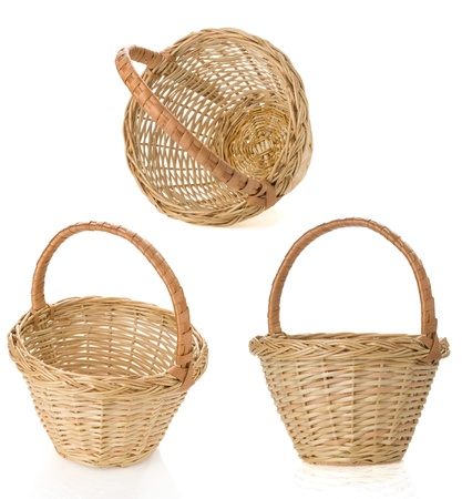 hand basket: wicker basket isolated on white background