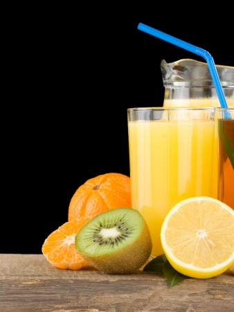 eat right: fresh fruits and juice in glass isolated on black background Stock Photo