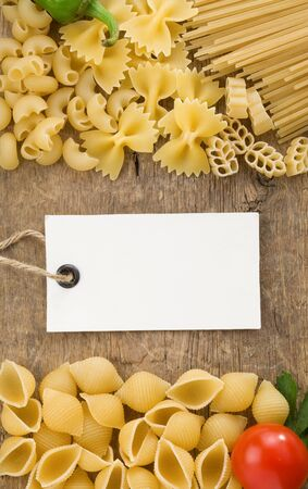 pasta and ingredients on wooden background photo