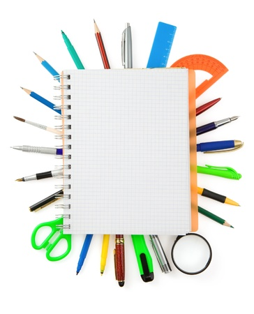 school supplies and checked notebook isolated on white background Stock Photo