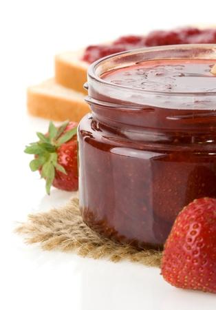 strawberry jam isolated on white background photo