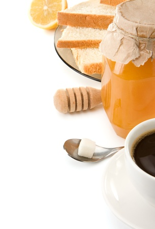 coffee, honey and bread isolated on white background photo