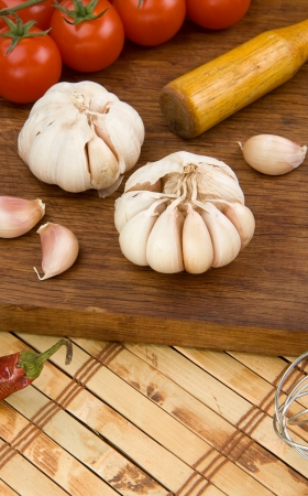 set of garlic nutrition and healthy food on wooden texture photo
