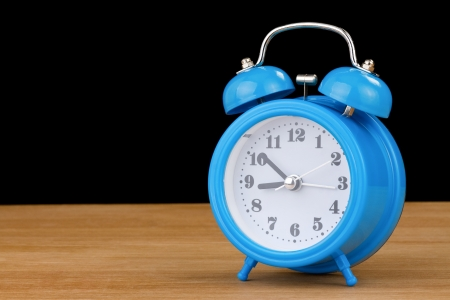 alarm clock watch  on wood background photo