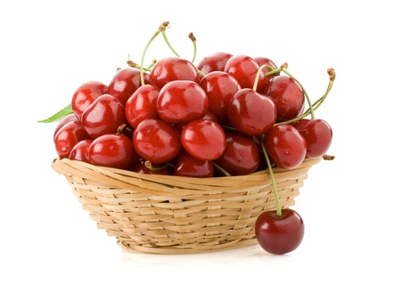 sweet cherry in  bowl isolated on white background photo