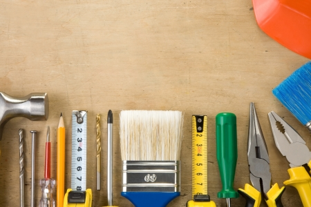 kit of construction tools and instruments on wood texture background photo