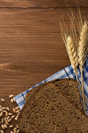 rye bread and ears of wheat on napkin photo