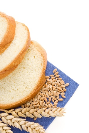sliced bread and ears of wheat isolated on white background photo