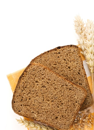 rye bread and ears of wheat isolated on white background photo