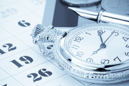 calendar background: ink pen and coin money on calendar background Stock Photo