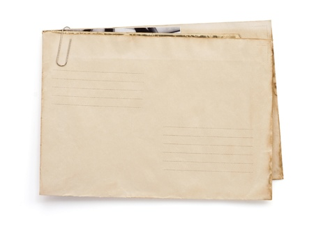 old vintage envelope isolated on white background photo