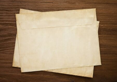 old postal envelope on wood background photo