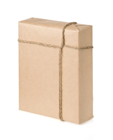 parcel wrapped with brown paper tied rope isolated on white background photo