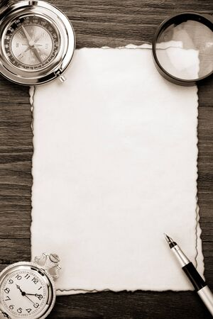 ink pen and compass on parchment background texture photo