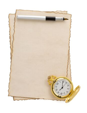 ink pen and watch at parchment isolated on white background photo