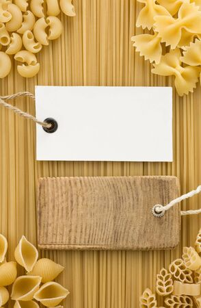 raw pasta on sack background photo